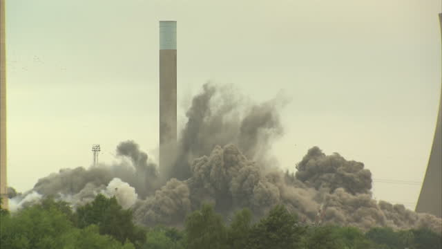 exterior wide shot the boiler house of didcot power station being demolished explosion and plume of smoke - didcot stock videos and b-roll footage