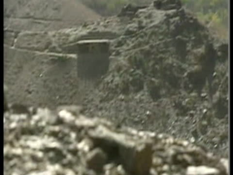 exterior wide shots arid border mountains of panjshir valley gun barrel and trench positions and militant holding missile launcher exterior shots of... - panjshir valley stock videos and b-roll footage