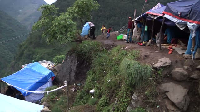 Exterior wide shots of a village of temporary shelter on a hillside for victims of the earthquake that hit in April 2015 Filmed on May 16 2015 in...