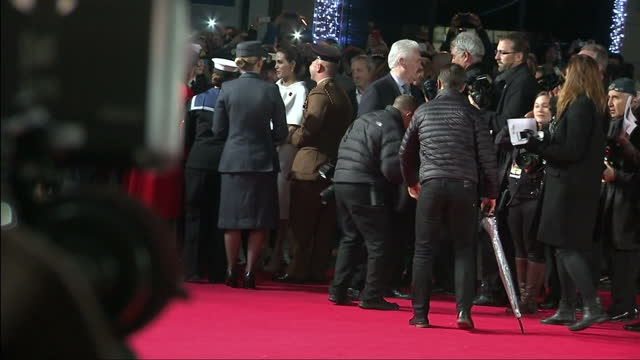 Exterior wide shots of actress and director Angelina Jolie on the red carpet at the UK premiere of 'Unbroken' signing autographs and speaking to a...