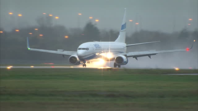 Exterior wide shots of an Enter Air plane landing at Glasgow Airport and taxiing The first Syrian refugees have landed on November 17 2015 in Glasgow...