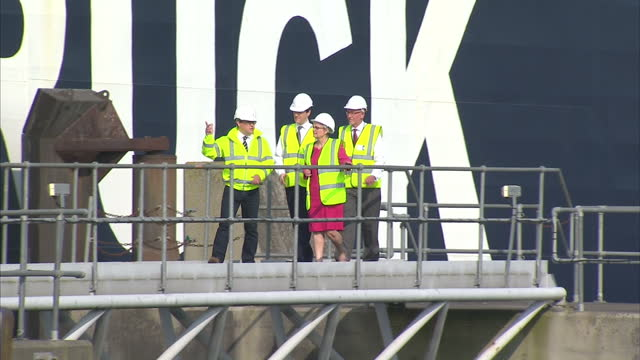 Exterior wide shots of Chancellor George Osborne wearing hard hat and high visibility jacket on visit around Warrenpoint on June 06 2016 in...