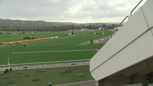 exterior wide shots of cheltenham race course as officials check on the course and press and visitors gather in preparation for the gold cup on 13... - cheltenham stock videos & royalty-free footage