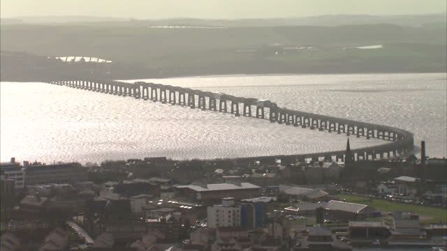 exterior wide shots of dundee, including the tay rail bridge and construction cranes at the waterfront development on march 14, 2017 in dundee,... - スコットランド ダンディー点の映像素材/bロール