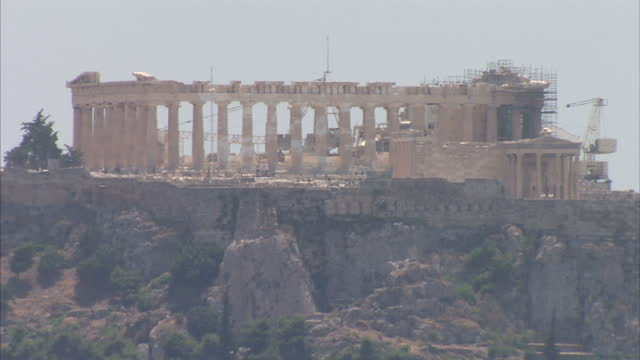 exterior wide shots of iconic landmarks including the acropolis and the church of saint panteleimon on july 15 2015 in athens greece - acropolis athens stock videos & royalty-free footage
