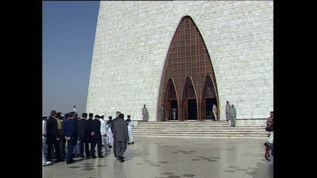 exterior wide shots of jinnah's tomb and queen elizabeth ii arriving during an official visit on october 9 1997 in karachi pakistan - karachi stock videos and b-roll footage