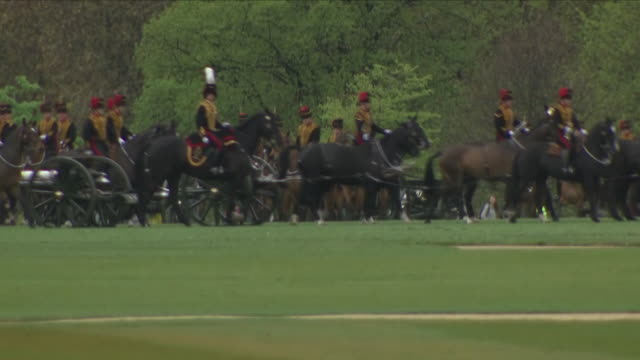 exterior wide shots of king's troop royal horse artillery riding into hyde park the 13pounder field guns for 41round salute in honour of the birth of... - king royal person stock videos and b-roll footage
