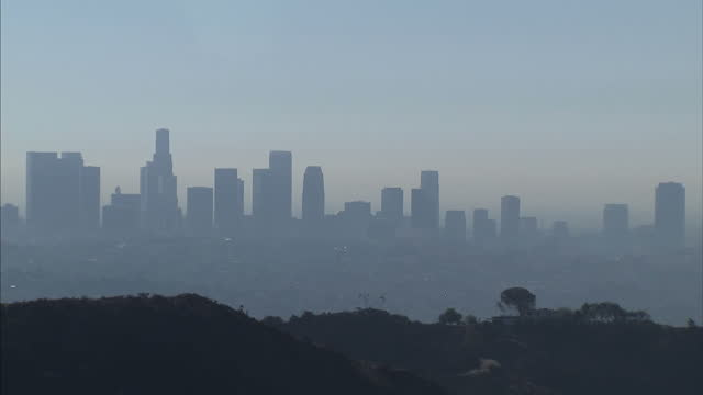 Exterior wide shots of Los Angeles skyline covered with a thick blanket of smog pollution swept in from the Sahara on April 02 2014 in Los Angeles...