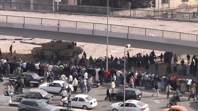 exterior wide shots of military tanks driving through streets filled with protesters, some throwing objects on february 3, 2011 in cairo, egypt. - revolution stock videos & royalty-free footage