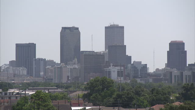 exterior wide shots of new orleans' city skyline with various high rise buildings on august 28 2015 in new orleans louisiana - levee stock videos & royalty-free footage
