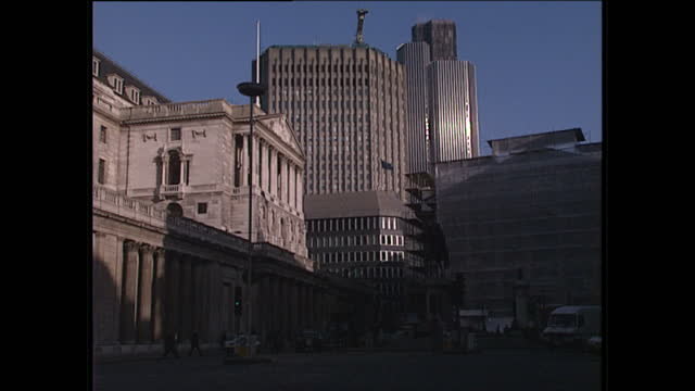 Exterior wide shots of people traffic passing the Bank of England and Tower 42 in the background January 26 1989 in London England
