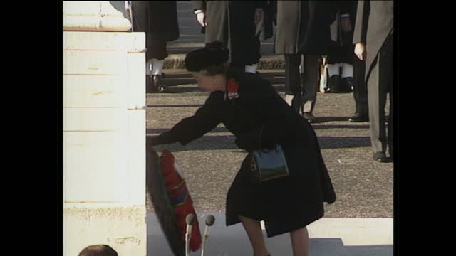 Exterior wide shots of Queen Elizabeth II and Prince Philip Duke of Edinburgh laying a wreath at the Cenotaph and Princess Diana Princess of Wales...
