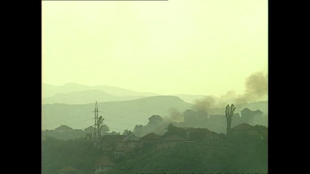 exterior wide shots of sarajevo skyline with smoke billowing from buildings & explosions going off in may 1992 in sarajevo, bosnia and herzegovina. - bosnian war stock videos & royalty-free footage