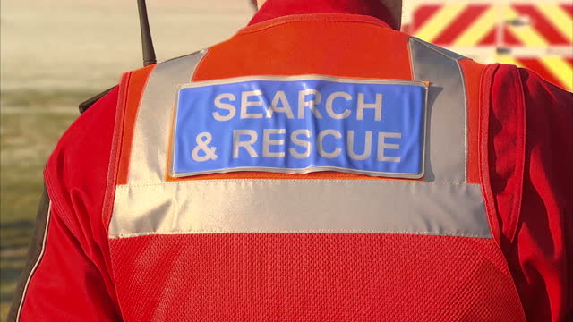 exterior wide shots of search rescue teams gathered to find clues in woodland areas about the disappearance of raf airman corrie mckeague including... - missing persons stock videos & royalty-free footage