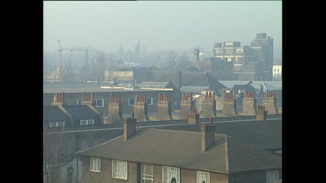 exterior wide shots of smog from pollution over london on january 19 1989 in london england - skyline stock videos & royalty-free footage