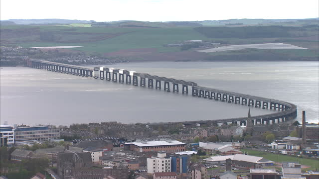 exterior wide shots of the skyline over dundee city and the tay road bridge on may 1, 2015 in dundee, scotland. - スコットランド ダンディー点の映像素材/bロール