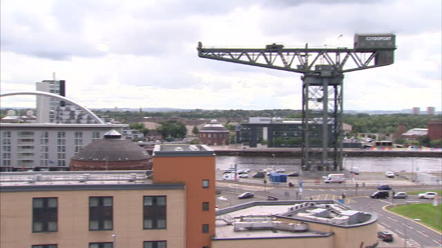 exterior wide shots of the university of glasgow spire trinity college towers clyde arc bridge finnieston crane overlooking the river clyde on august... - spire stock videos & royalty-free footage