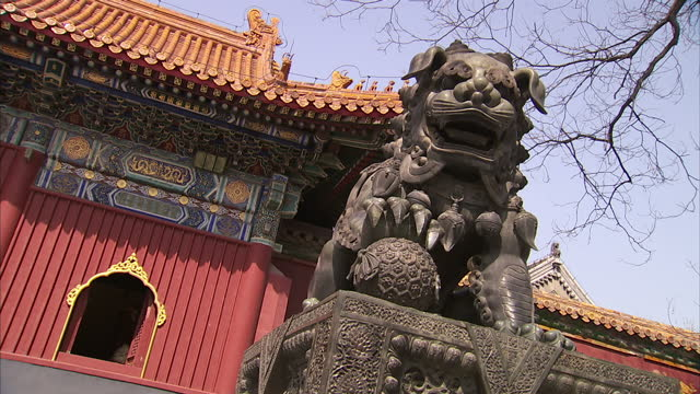 exterior wide shots of the yonghe temple also known as the yonghe lamasery and close up shots of an ancient bronze guardian lion statue scripts on... - lamasery stock videos and b-roll footage