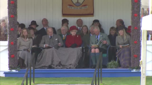 exterior wide shots queen elizabeth ii prince philip duke of edinburgh and prince charles prince of wales autumn phillips watching braemar highland... - highland games stock videos & royalty-free footage