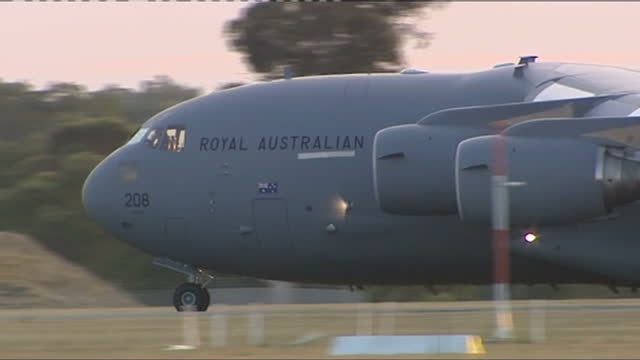 exterior wide shots raaf c17 c17 globemaster 3 transporter plane taxiing at raaf base pearce on march 28 2014 in near perth australia - taxiing stock videos & royalty-free footage