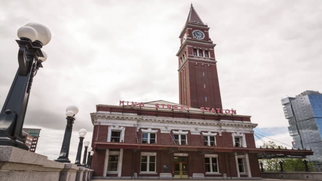 exterior w/s time lapse of the king street station in seattle, wa on an overcast day as dark clouds roll in the background - filiz stock videos & royalty-free footage