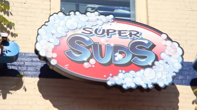exteriors and interior shots of super suds laundromat in reading pennsylvania on december 12 laundromat signage wide shot of various detergent brands... - laundry detergent stock videos and b-roll footage