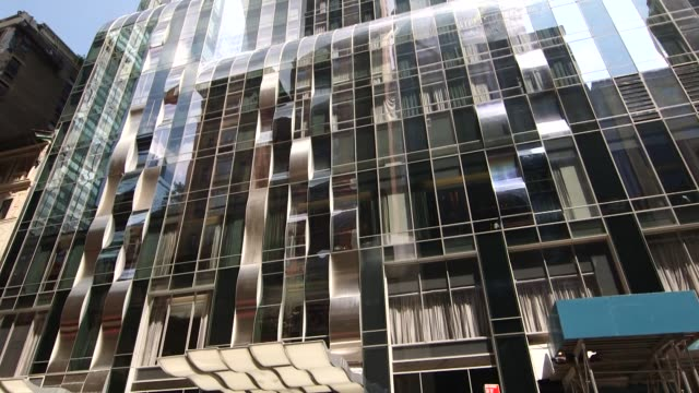 exteriors and signage of the park hyatt hotel in new york ny on august 26 2014 pedestrians walk past the park hyatt hotel park hyatt new york signage - markenname stock-videos und b-roll-filmmaterial