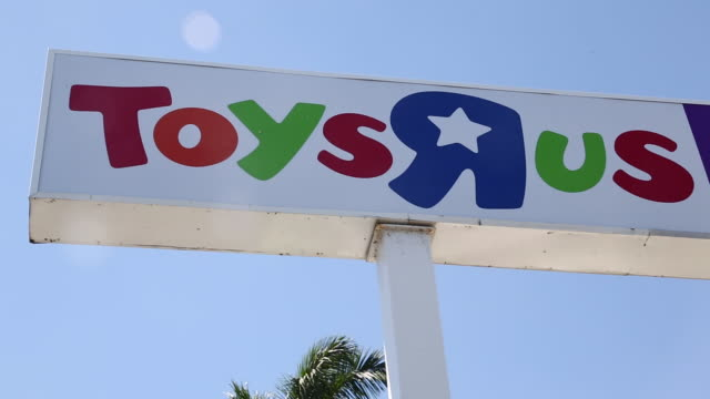 exteriors and signage of toys r us and babies r us in miami florida on thursday march 15 2018 - toys r us stock videos and b-roll footage
