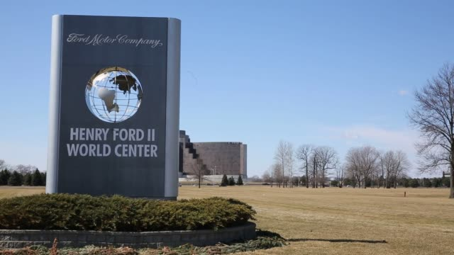 exteriors and signage shots of the ford motor company headquarters in dearborn michigan close up shot of a sign reading henry ford ii world center... - dearborn michigan stock videos and b-roll footage