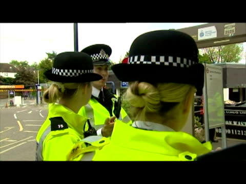 exteriors british transport police officers setting up portable metal detector outside pinner station & instructing mostly young men to empty their... - セキュリティスキャナ点の映像素材/bロール