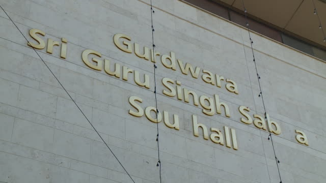 exteriors gurdwara sri guru singh sabha sikh temple in southall london - temple building stock videos & royalty-free footage
