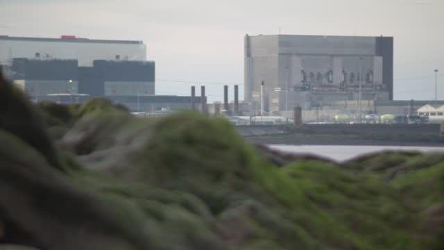 exteriors heysham nuclear power station, uk - radiation stock videos & royalty-free footage