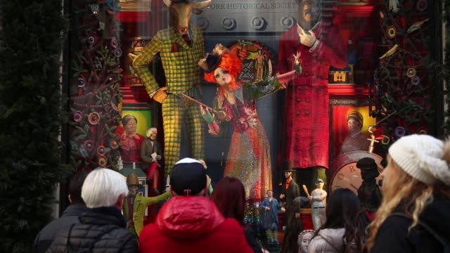 exteriors of a bergdorf goodman and holiday windows in nyc on december 3 2017 photographer timothy fadek shots wide tilt down of signage to entrance... - bergdorf goodman stock videos and b-roll footage