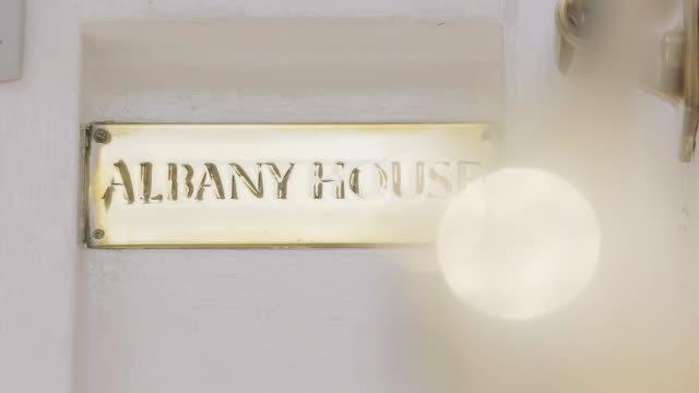 cu pan exteriors of albany with name plate / london, england, united kingdom - name tag stock videos and b-roll footage