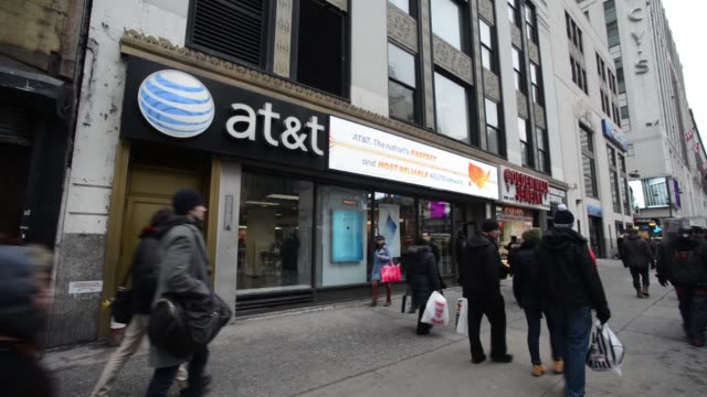 Exteriors of an ATT store location on west 34th street in Manhattan New York Street scene shots of New Yorkers walking past the entrance of an ATT...