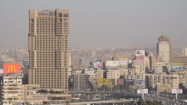 exteriors of cario city skyline skyscrapers apartment buildings and traffic on january 28 2015 in cairo egypt - cairo stock videos & royalty-free footage