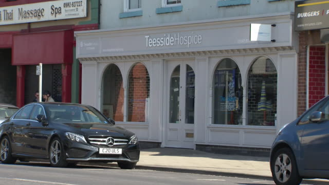 exteriors of charity shops for teeside hospice that have be forced to close during the coronavirus crisis, middlesborough - closed stock videos & royalty-free footage