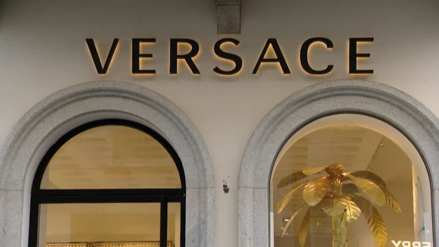 """exteriors of designer clothes shops in milan closed dueu to coronavirus pandemic - """"bbc news"""" video stock e b–roll"""