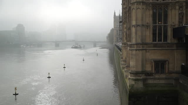 exteriors of houses of parliament, london, in the autumn fog - politics stock videos & royalty-free footage