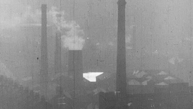 vídeos de stock e filmes b-roll de 1939 montage exteriors of industrial factories in operation / united kingdom - revolução industrial