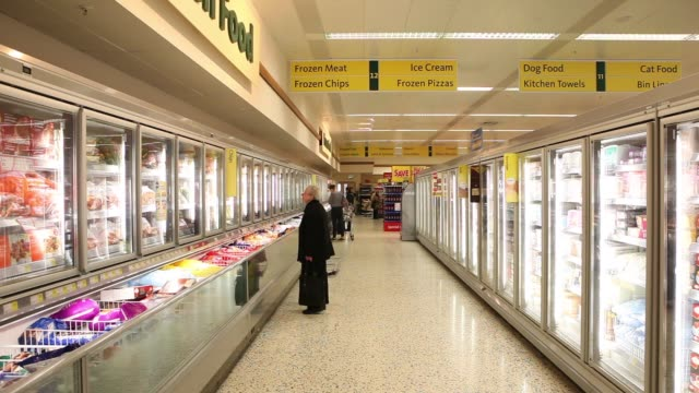 exteriors of morrisons grocery store / signage/ food shoppers / frozen food section / produce / aisles / food carts / sale signs morrisons grocery... - frozen food stock videos & royalty-free footage