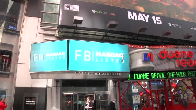 exteriors of nasdaq in times square / facebook signage outside of nasdaq / people waiting for trading to begin facebook ipo nasdaq on may 18, 2012 in... - ナスダック点の映像素材/bロール
