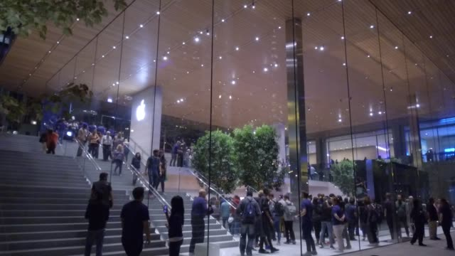 Exteriors of new Apple store during the Grand Opening event at night in Chicago IL on October 20 2017 Photographer Dan Acker Shots wide shot of...
