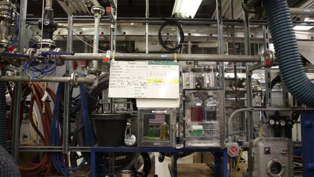 exteriors of patuxent river naval air base / interiors of biofuel research / beakers with camelina and algae samples / finished products/ lab... - algae fuel video stock e b–roll