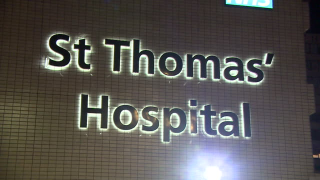 exteriors of st thomas' hospital where uk prime minister boris johnson is in intensive care receiving treatment for coronavirus - night stock videos & royalty-free footage