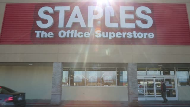 Exteriors of Staples in Clawson Mich on Monday Feb 29 2016 Shots Wider shot of of doors Medium shot of sign by road cars driving by Wider shot of...