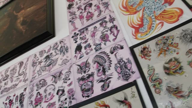 exteriors of tattoo city tattoo parlor in san francisco california interior shots of tattoo designs displayed along the interior wall of a tattoo... - tattoo stock videos & royalty-free footage