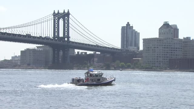 exteriors of the brooklyn bridge and manhattan bridge on july 24 2014 in new york city - police boat stock videos and b-roll footage