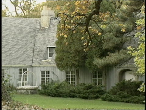 wgn exteriors of the home of the rouse family shot in 1996 after the 1980 murder of bruce and darlene rouse which their son william rouse later... - shooting crime stock videos & royalty-free footage