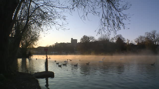 exteriors of windsor castle, with river thames in foreground, on morning of funeral of prince philip duke of edinburgh - twilight stock videos & royalty-free footage